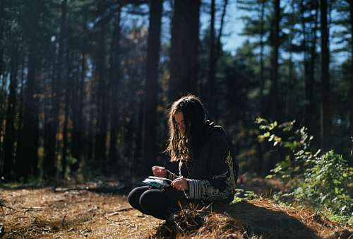 Woman reading at forest