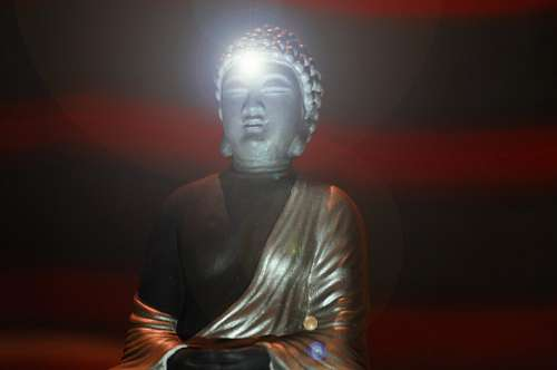 Statue of Buddha with flashes of light