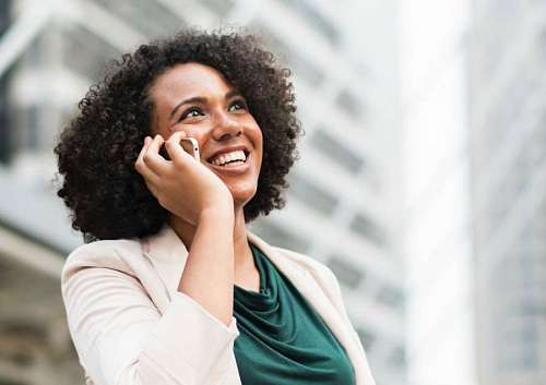 Woman talking by cellphone and smiling