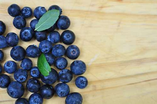 Top view of blueberries on wooden background