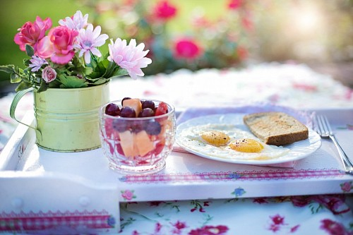 Toasts with egg and fruit salad