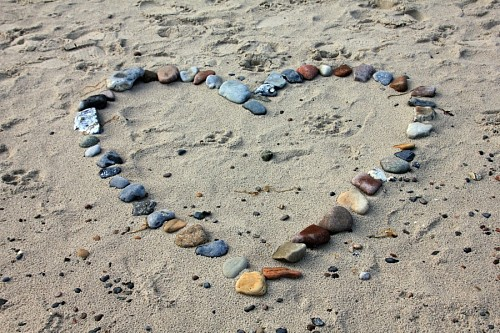 Love hd picture Heart formed with stones on the sand