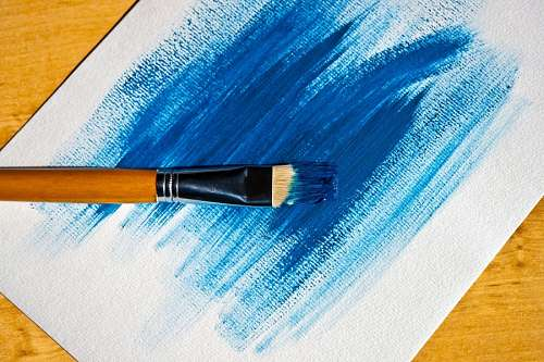 Brush with blue paint