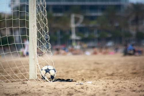 soccer sport ball, bow, red, shot, sand, front vie