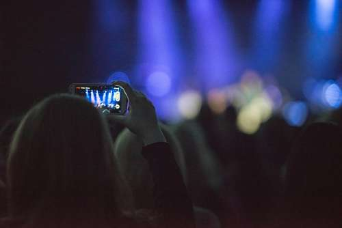 free images  A woman with cellphone in concert