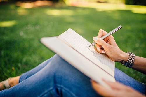 free images  Woman writing outdoors