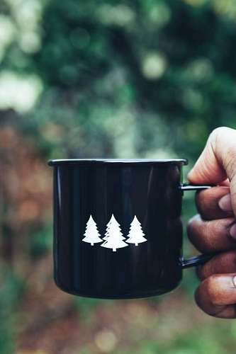Coffee cup with pine trees