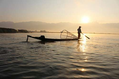 free images  Fisherman at Myanmar lake