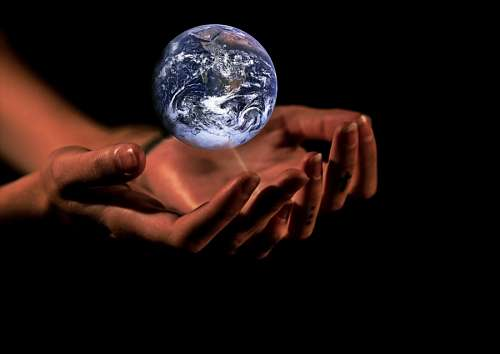 Woman hands holding the world
