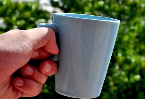 free images  Hand holding a cup