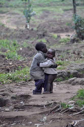 African children giving a hug