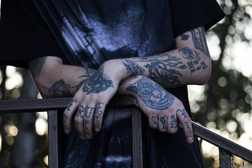 Hands of young man tattooed