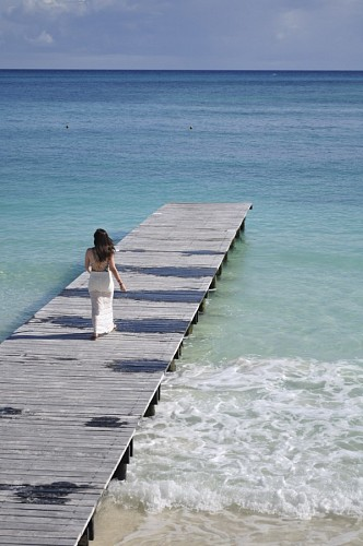 Woman walking on the quay of Cancun