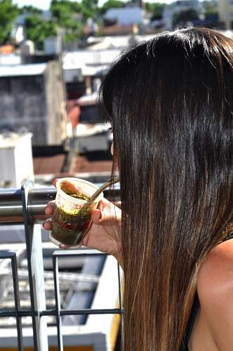 free images  Woman drinking mate on terrace