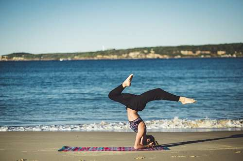 Woman doing yoga exersices beach