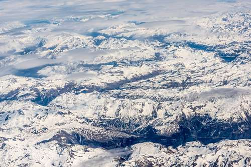 free images  Aerial view of snowy mountains