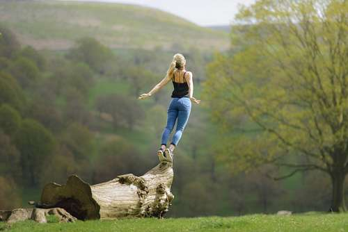 free images  Woman balancing on a trunk