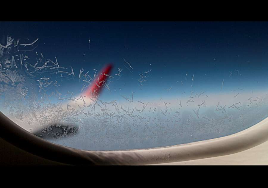 Image Of Ice Crystals In The Airplane Window Free Photo