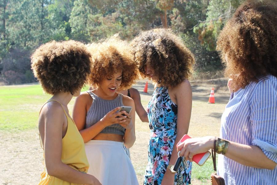woman, women, summer, exterior, telephone, cellular, message, laughter, joy, curler, curlers, hair, dark, meeting,