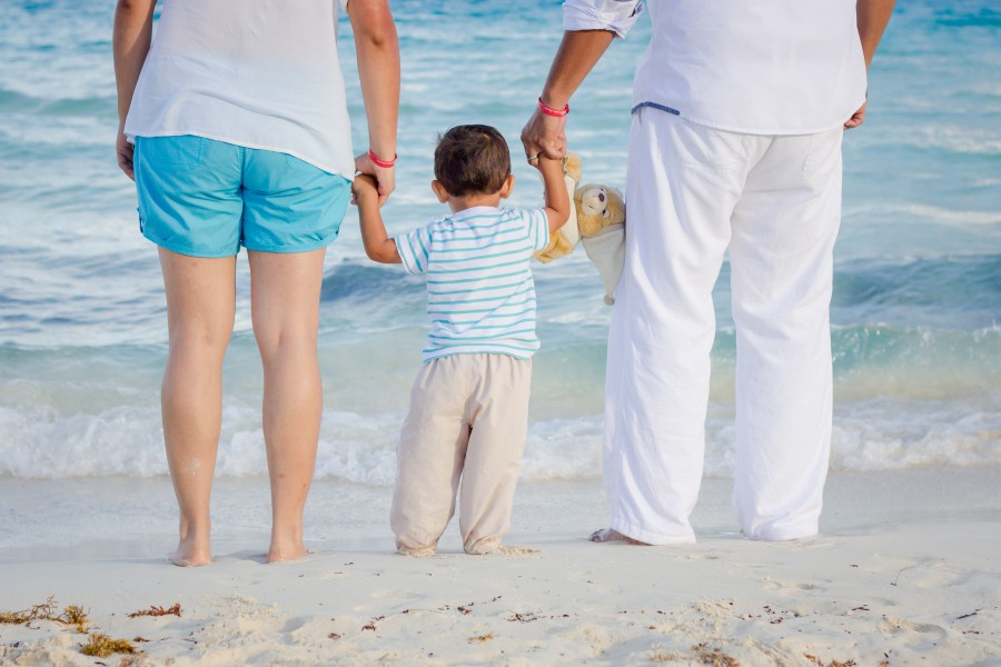Family, marriage, love, tenderness, son, parents, mom, dad, hands, beach, sea, family vacations, child, teddy bear