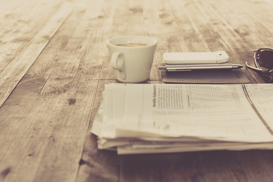 table, cell, daily newspaper, coffee, coffee, pen,