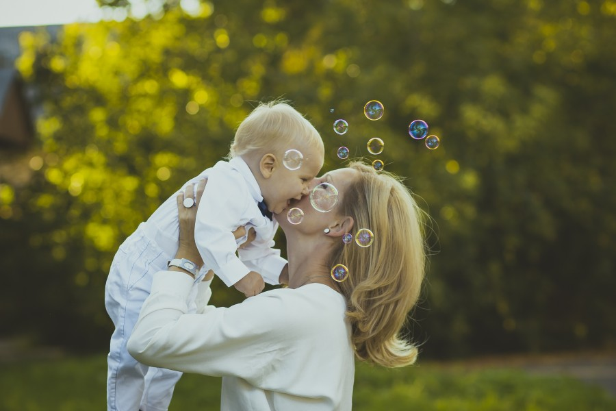 two people, mother, son, baby, child, blond, 6 months, love, kiss, adult, outdoor, bubble, lifting, lifting, foreground,