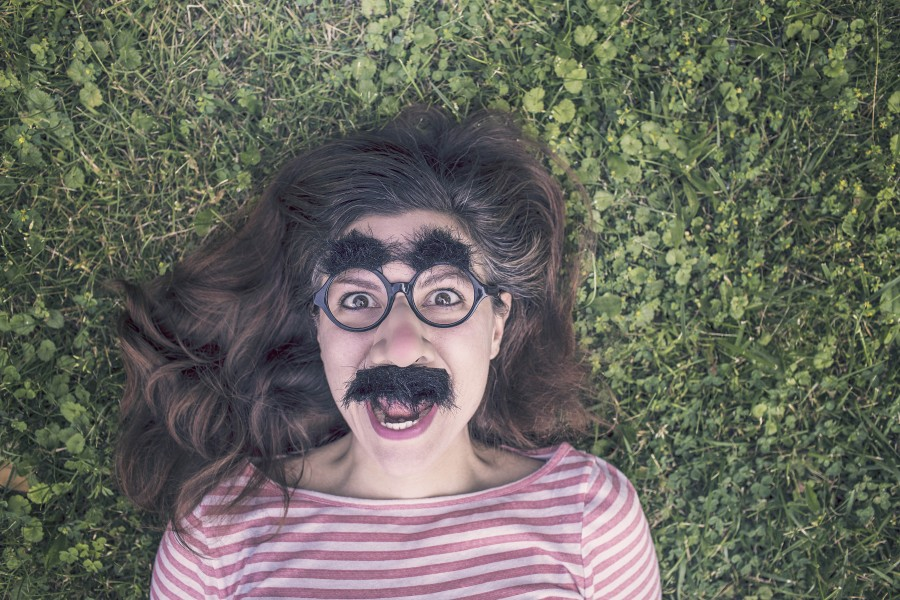 one person, people, woman, outdoor, concept, young, mustache, whisker, joke, funny, weird, mask,