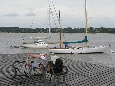 Loving couple on dock in Colonia, Uruguay