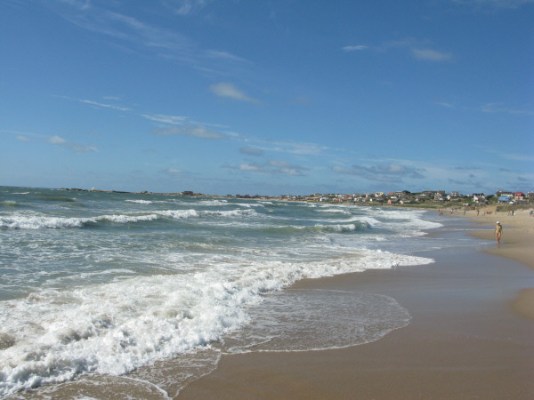 beach, sand, summer, day, outdoor, outside, front view, water, sea, coast, foam, out polonium, Uruguay, South america, america, latin america, landscape, city, looking, looking, looking, floor ,
