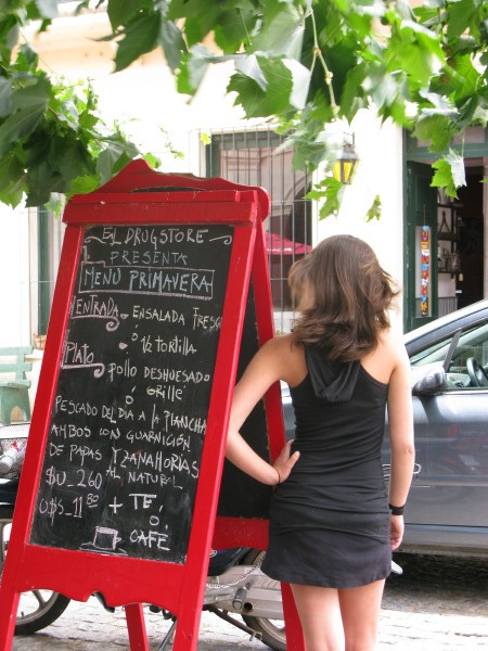 colony, Uruguay, south america, south america, america, one person, woman, seen from behind, elegant, sensual, leg, legs, poster, restaurant, care, concept, day, exterior, red, dress, black, young, ± os 20 years, 25 years ± os, 30 years ± os, letter